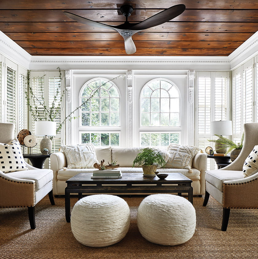 The sunroom's lustrous, wood-paneled ceiling contrasts with crisp-white walls and trim.