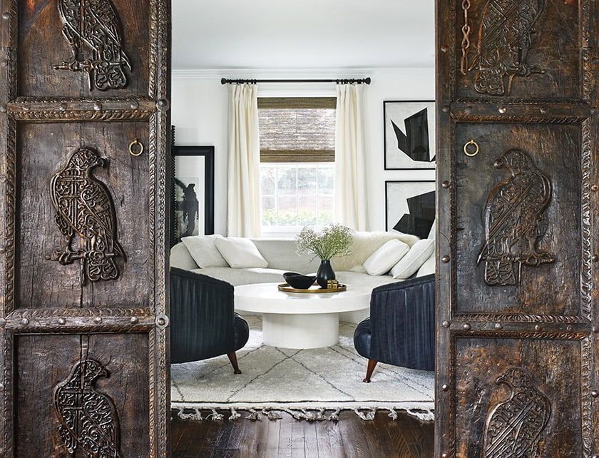 Antique panels from Pakistan separate the sunroom and living room.