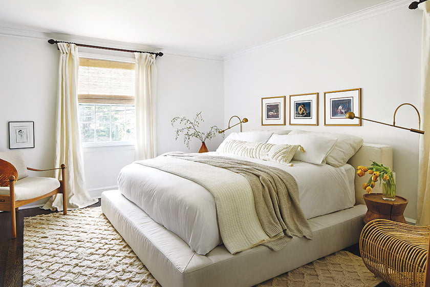 A low-slung RH bedstead sits atop a rug from Armadillo in the owners' bedroom.