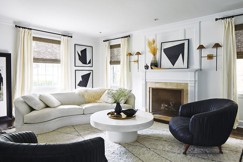 A restrained-modern vibe prevails in the living room, with graphic prints and a quiet palette.