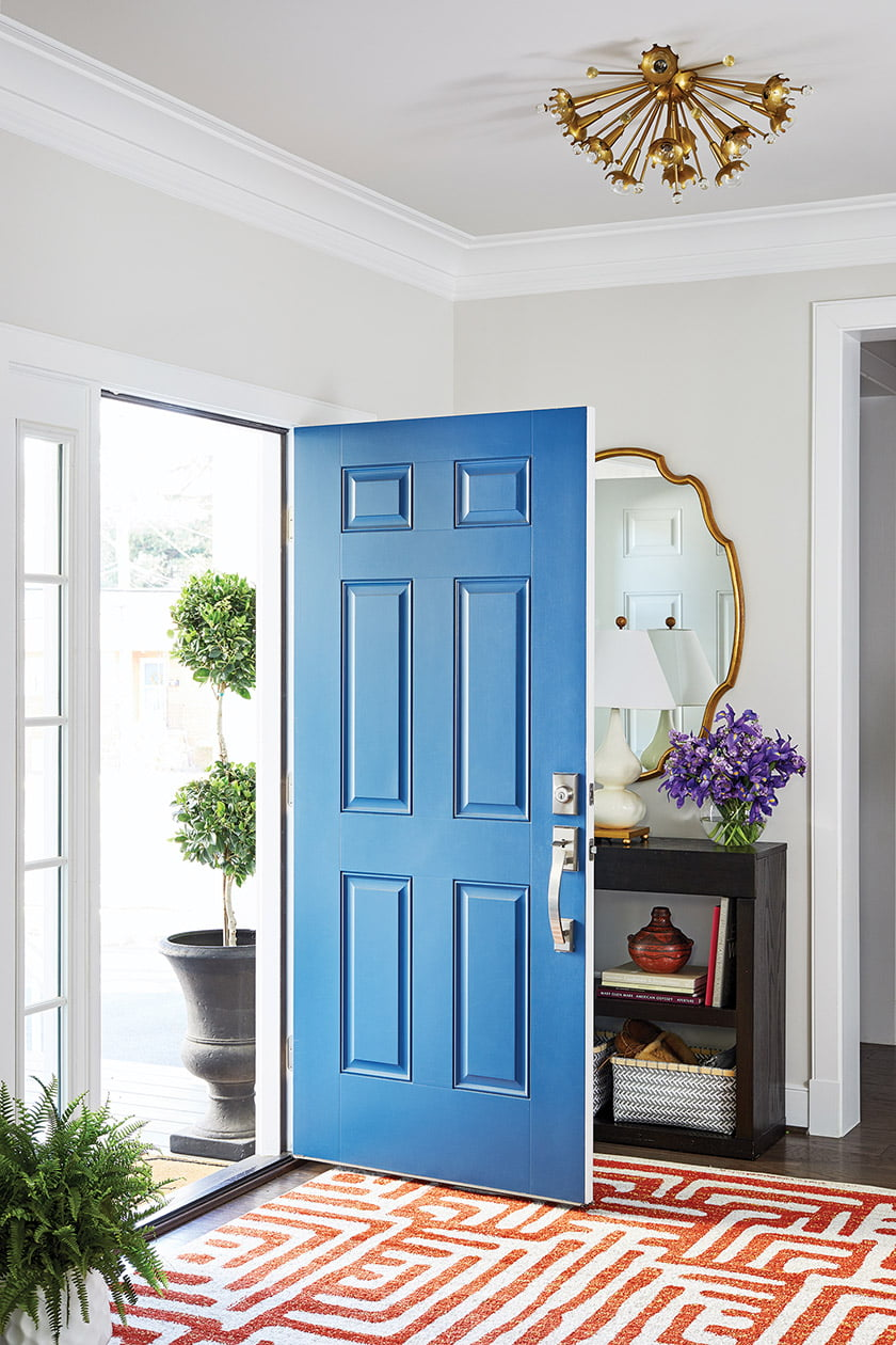 With its Jonathan Adler Sputnik fixture and vintage mirror, the entry strikes an eclectic note.