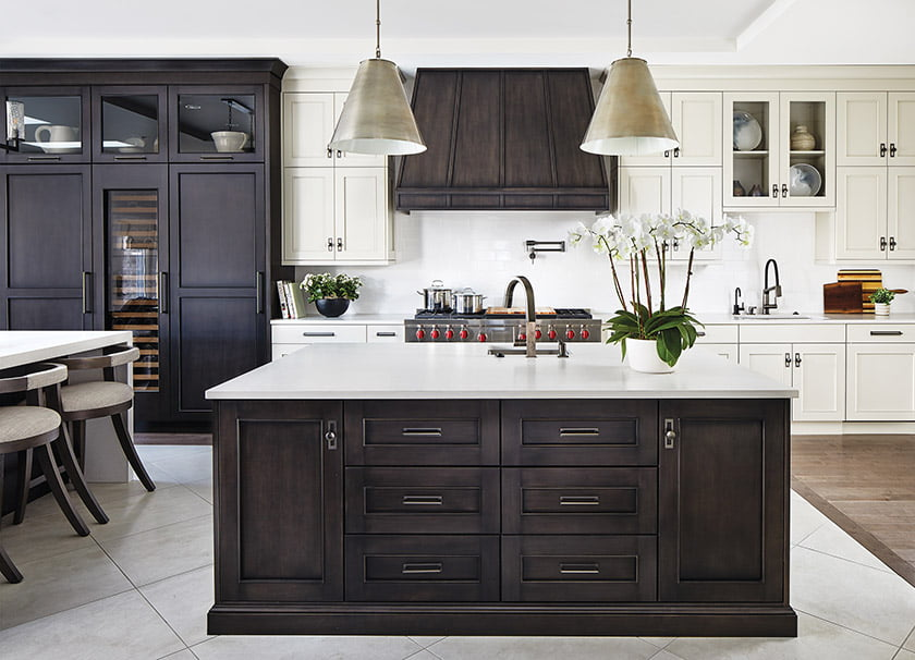 White-painted cabinetry and white  Caesarstone countertops are offset by glazed, dark-stained maple in this kitchen designed by Jack Rosen Custom Kitchens.