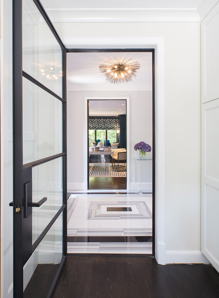 "Bonnie Ammon Interiors combined polished black porcelain with Thassos and Marmara Equator marbles in a custom foyer floor. ""Flooring is an important design element,"" says principal Bonnie Ammon. ""I like to make it impactful. I think of it as art for the floor.""   Photo: Geoffrey Hodgdon"