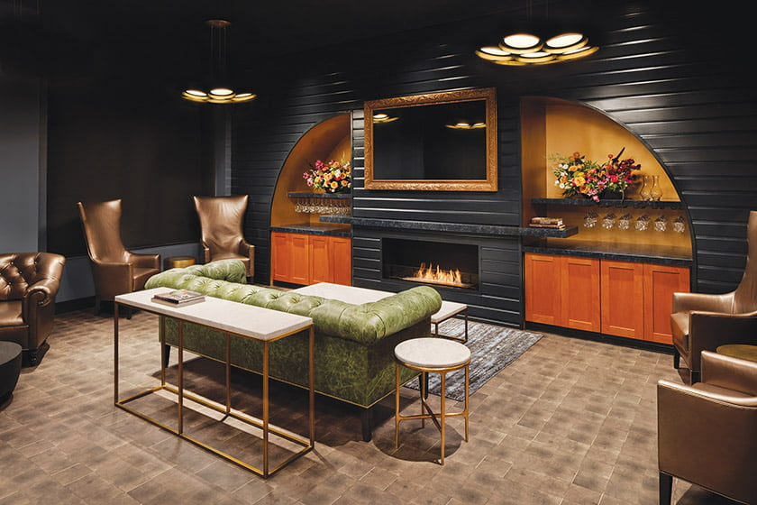 Members can sample wines fireside, seated on tufted sofas and lounge chairs by Jamie Stern Design. © Jennifer Hughes