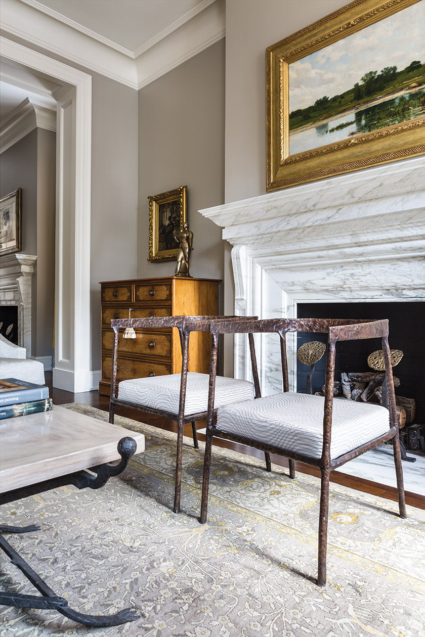 The team retained the existing marble-clad fireplaces in both adjacent parlors during the renovation.