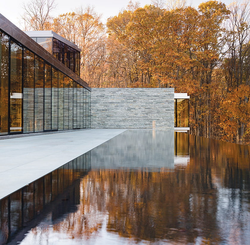 The expanse of glass and pool were inspired by the owner's childhood memory of a dream house sketched by his father but never built.
