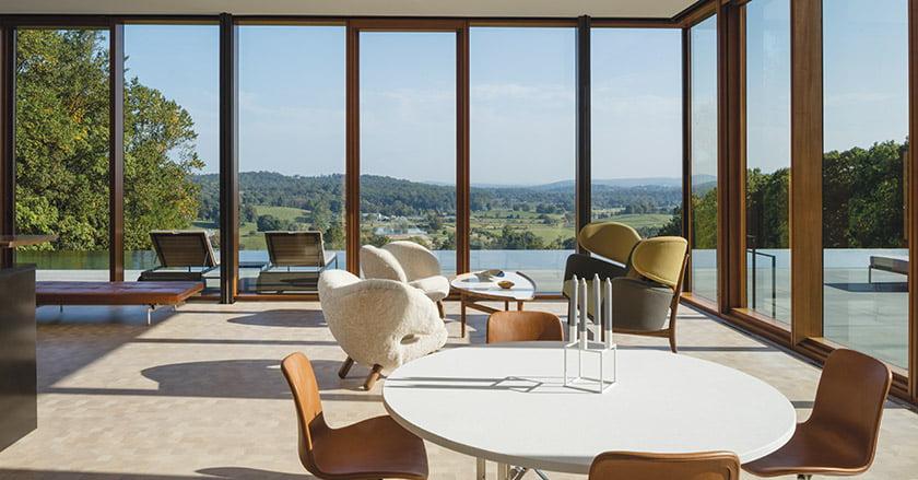 Scandinavian Mid-Century Modern furniture creates a casual vibe in the main living volume. Made of end-cut blocks of Douglas fir, the flooring evokes a minimalist tatami mat.