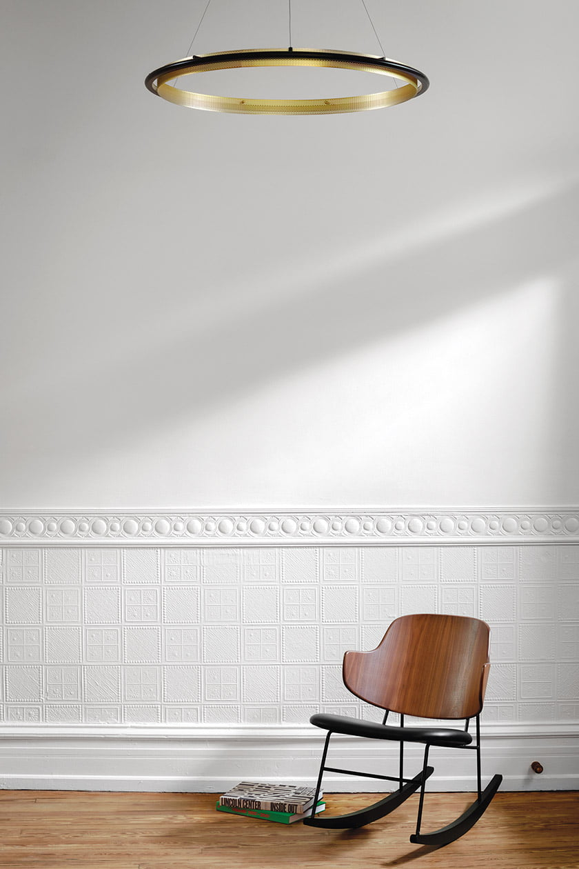 A Penguin chair by Ib Kofod-Larsen is at home in the entry hall. © Jennifer Hughes