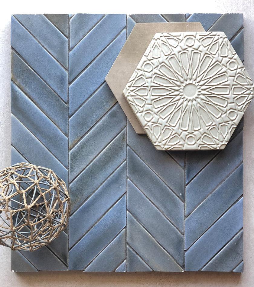 A mood board combines Heron matte glazed ceramic tile, handmade by Encore Ceramics; Landmark's Attitude hexagonal porcelain tile;  and Walker Zanger's decorative Fez glazed ceramic tile from Mexico.