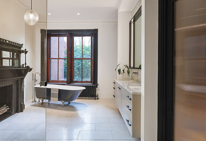 The owners' bath features an existing clawfoot tub—moved from the hall bath—that got a makeover. © Anice Hoachlander