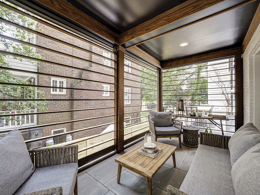 Wood slats cleverly reference their glass predecessors on the new screened porch.