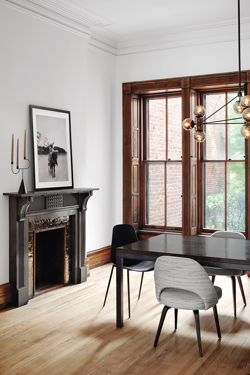 The dining room fireplace has been dressed up with with black paint. © Jennifer Hughes