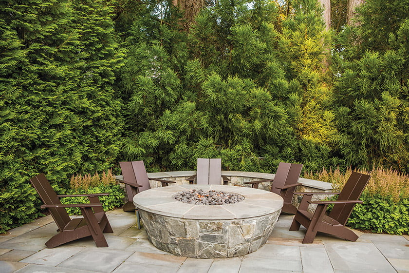 A circular stone fire pit beckons visitors.