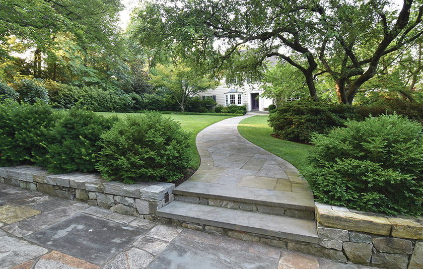 A winding flagstone path leads to the home's front entrance.