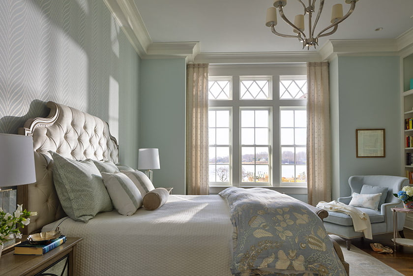 Subtle, herringbone-patterned wallpaper from Thibaut lines one wall in the owners' suite. Photo: Durston Saylor