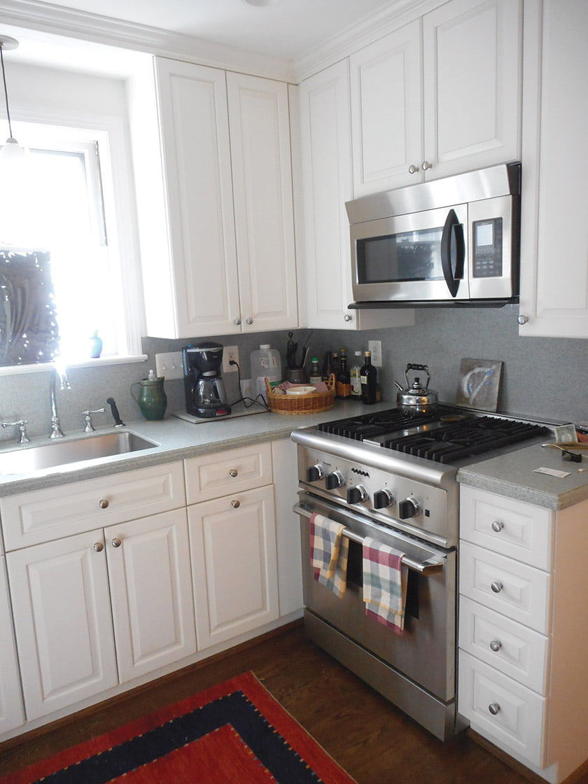 BEFORE: The previous kitchen was cramped and outdated.