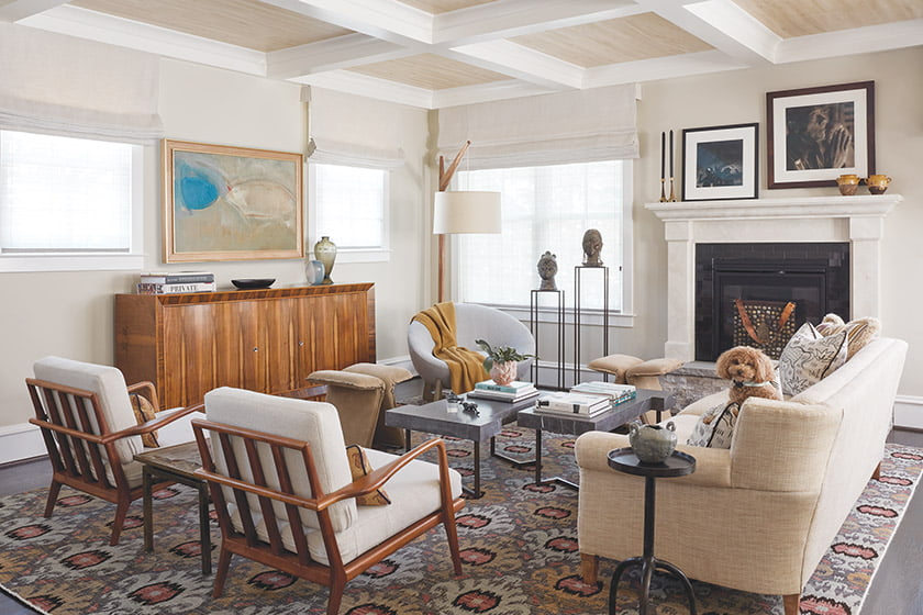 The family room combines a pair of Mid-Century chairs, a vintage French cabinet and a Moroccan-style rug.