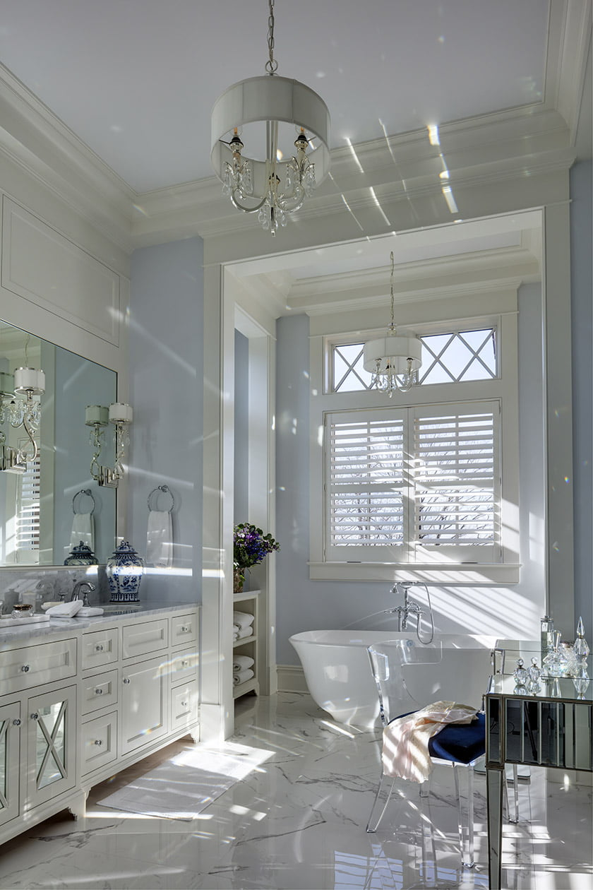 The owners' bath boasts marble flooring and countertops. Photo: Durston Saylor