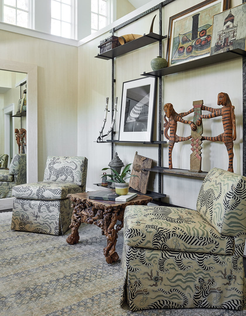Ferrell Mittman slipper chairs are covered in Clarence House fabric.