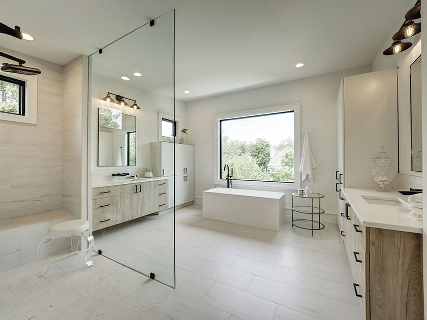 A large glass partition borders the shower.
