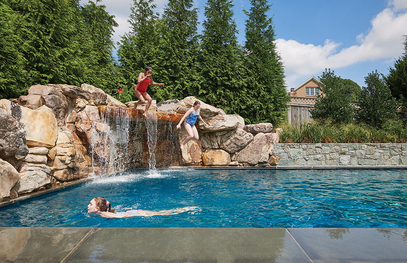 A pile of Tennessee stone doubles as a waterfall and jumping-off point into the pool.