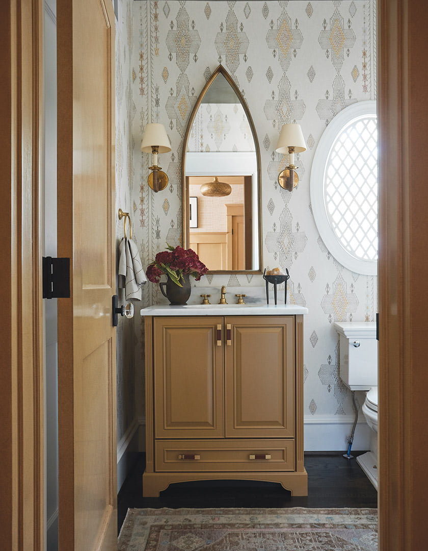 Hildreth transformed a mundane powder room with a new stone countertop, a custom Moroccan-style window grate and Kit Kemp wallpaper.