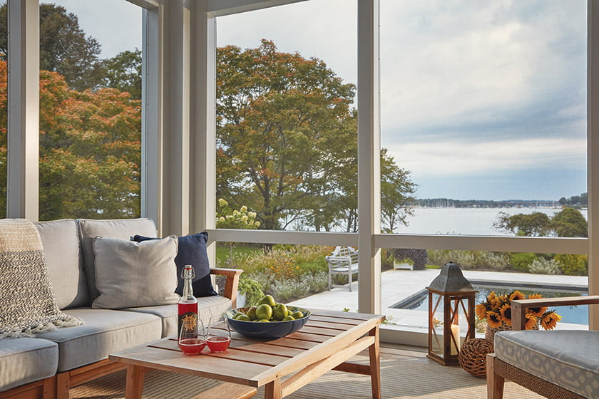 A screened porch offers a bug-free spot for socializing and view-gazing. Photo: David Burroughs