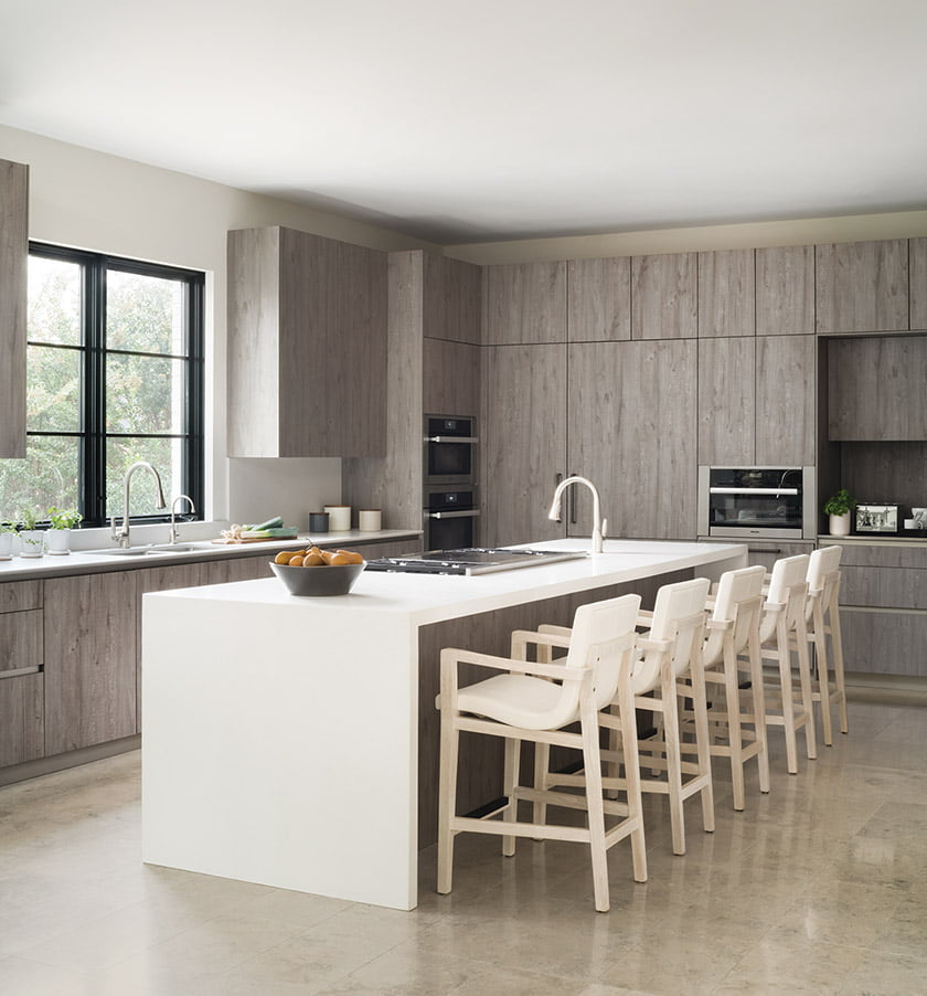 The sleek kitchen designed by Shawna Dillon of Snaidero DC Metro centers on an island with quartz countertops and Holly Hunt stools.