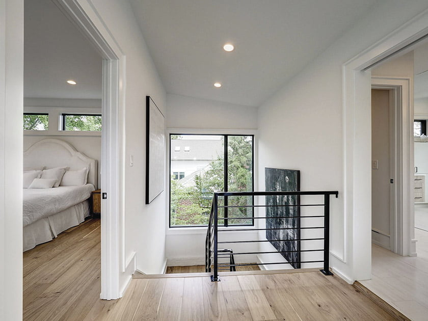 A separate stairway accesses the third-floor owner's suite. The bedroom and roof deck are on the left and the bath is to the right.