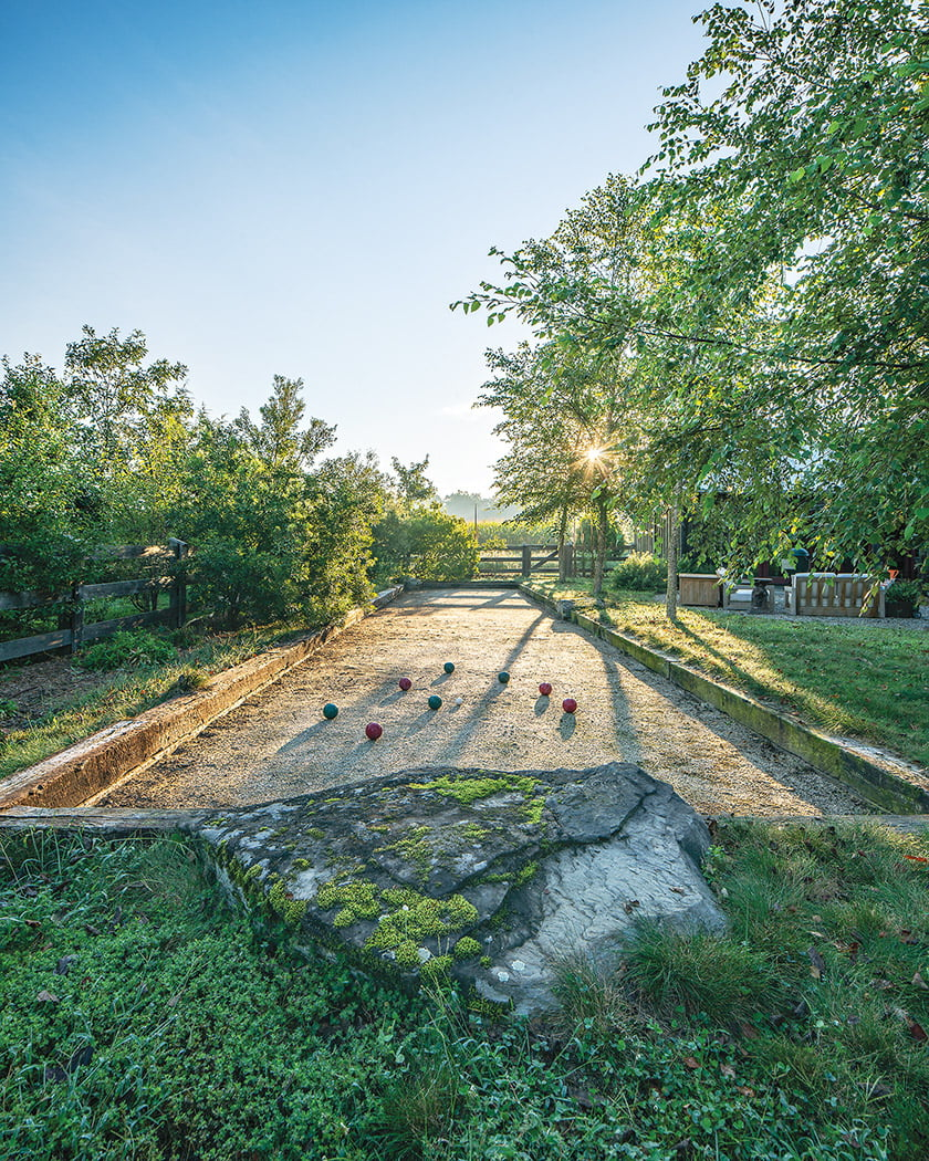 The owners and their guests enjoy games of bocce amid the greenery.