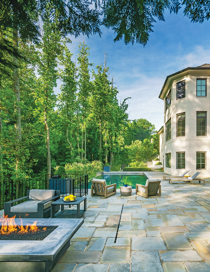 A new stairway leads to the backyard lawn, pool and fire pit.