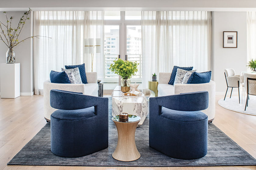 Meyer selected a striking blue-and-white palette in the living area, which houses  A. Rudin chairs and matching sofas on a Laloi rug.