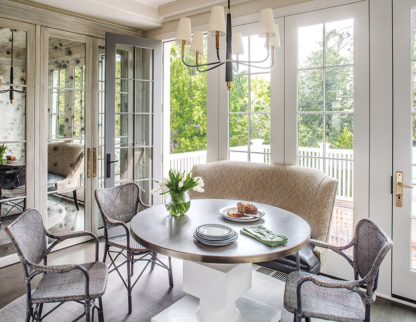 The breakfast area opens to a deck overlooking the verdant backyard.