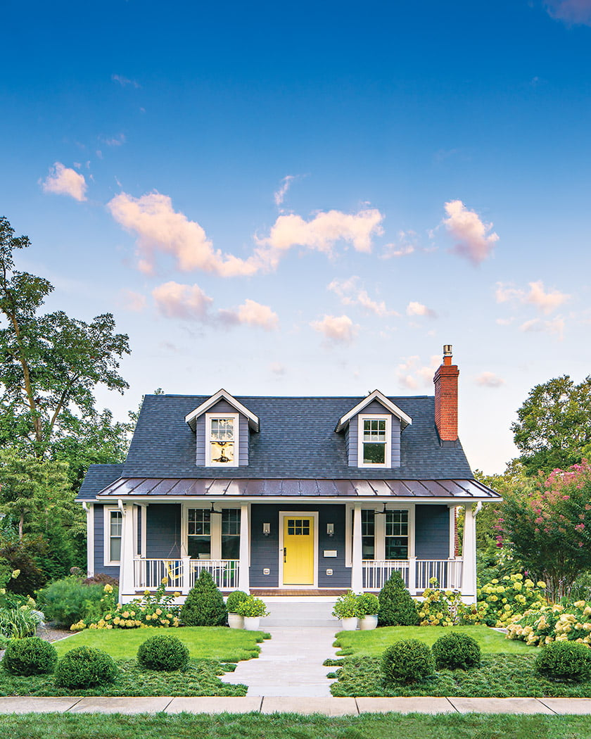 """Brinitzer staggered the stonework on the front walk, flanked by zoysia and """"gum drops"""" of dwarf mondo grass."""