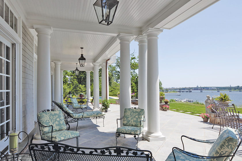Also by Hammond Wilson, a traditional home on the Severn River boasts a covered terrace with a beadboard ceiling and stone floor. PHOTO: Anne Gummerson