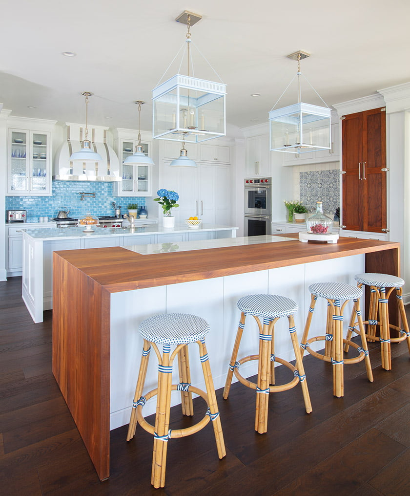 The crisp-white kitchen is punctuated by bright blue Walker Zanger backsplash tile.