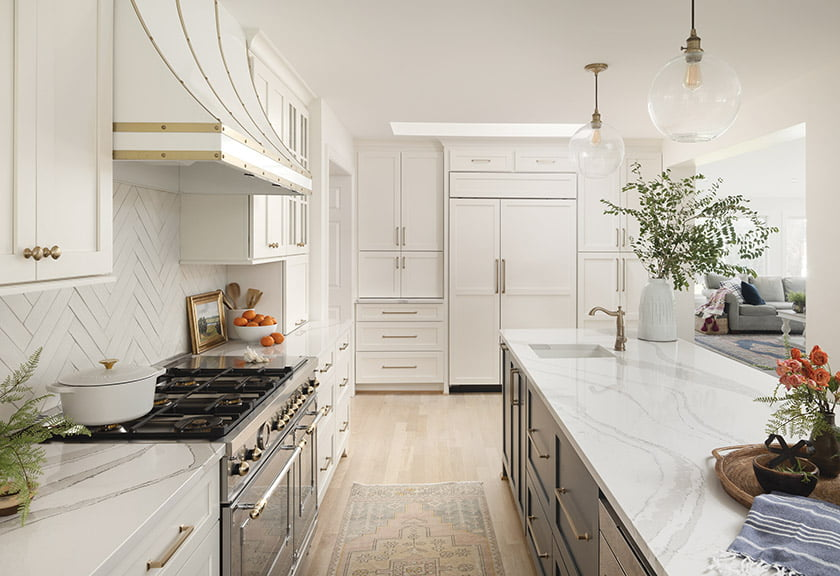 Custom cabinetry is complemented by a custom range hood trimmed in brass.