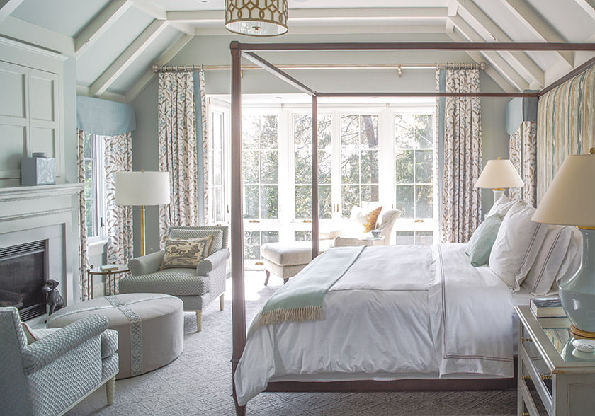 To match the scale of the vaulted ceiling in the owners' bedroom, Sroka specified a pencil-post bed from Hickory Chair.