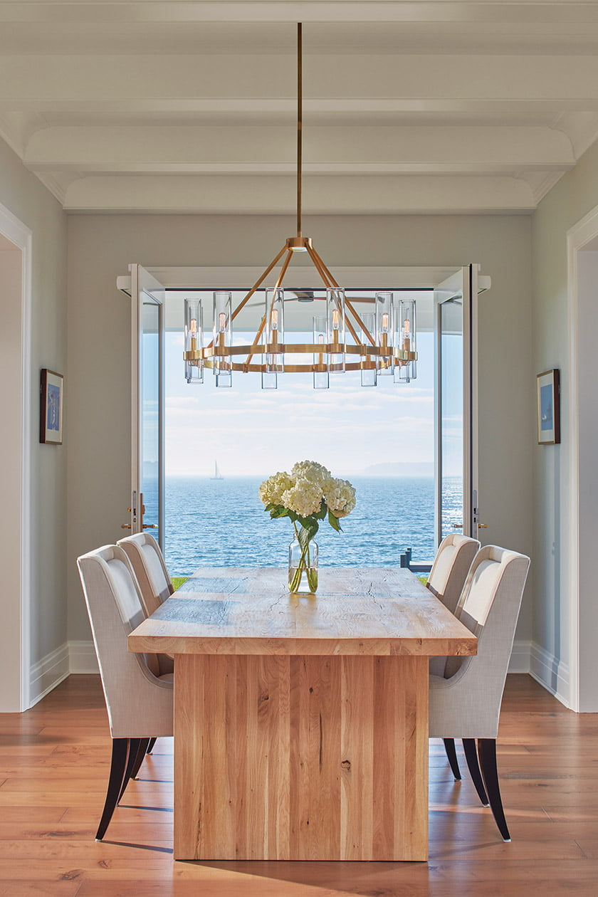 An expansive South River vista is visible through glass doors in an Annapolis dining room, part of a custom home designed by Alt Breeding Schwarz and built by Bayview Builders. PHOTO: DAVID BURROUGHS