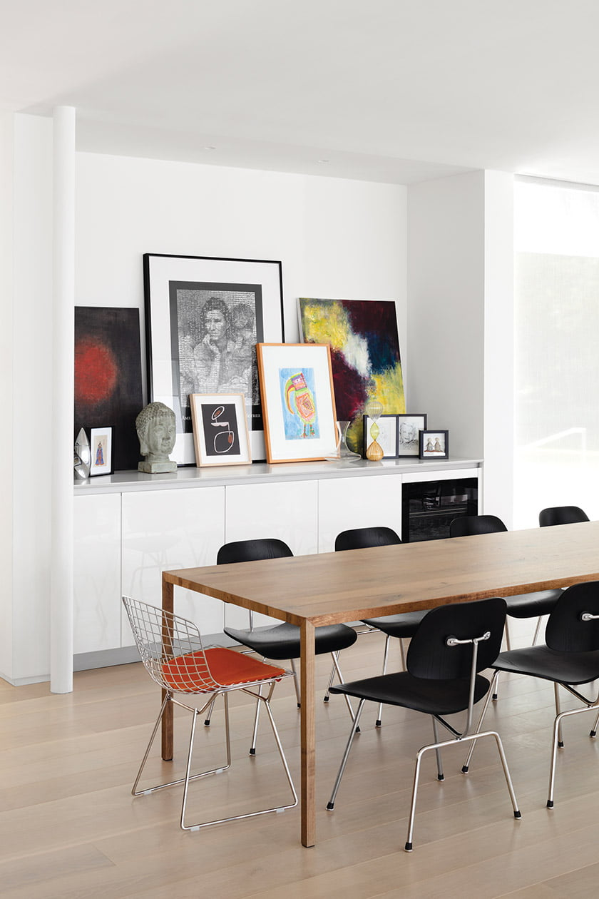 A collection of photographs, family artwork and mementoes sits atop a Snaidero credenza.
