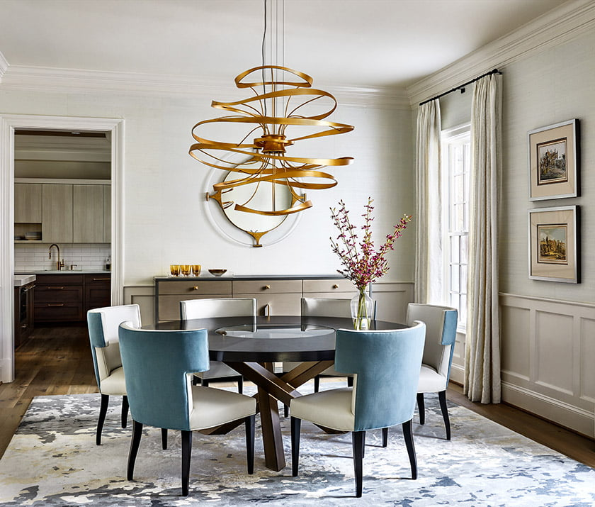 In the dining room, swirls of brass on the Corbett chandelier suggest fluid harmonies, a reference to the owners' love of music.