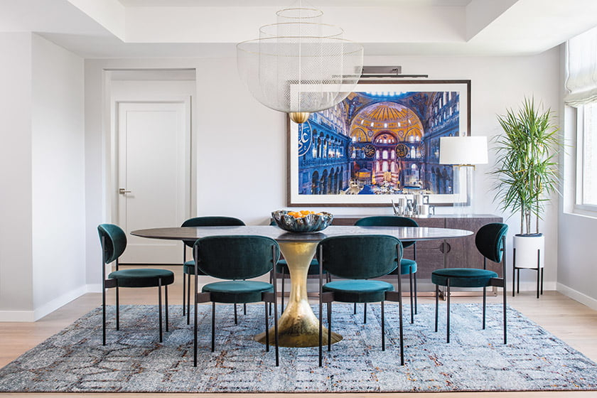 A photograph of Istanbul's Hagia Sophia makes a bold statement in the dining room. The hammered-steel base of the Julian Chichester table and a hand-knotted, wool-and-silk rug from C. G. Coe & Son add subtle contrast.