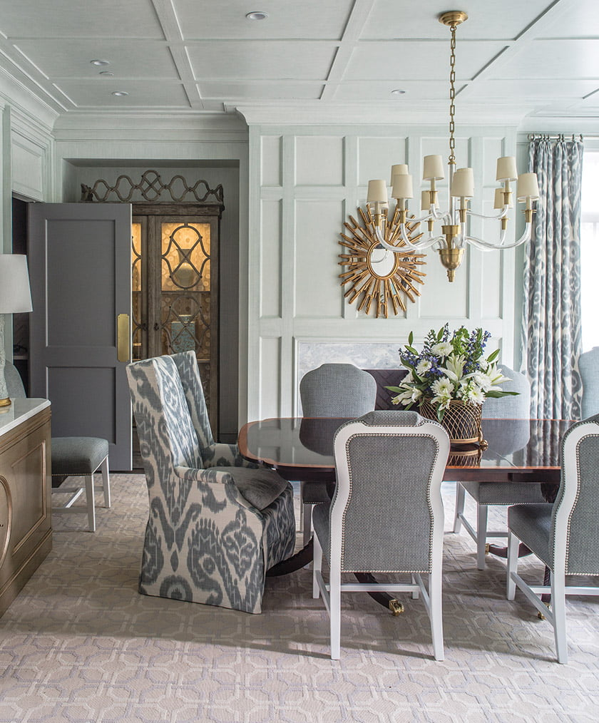 "In the dining room, Sroka mixed two chair styles around an existing table to create a ""homey feel."""