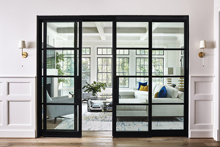 Armstrong reconfigured the entry hall, replacing an intrusive wall with glass doors that open views to the family room.