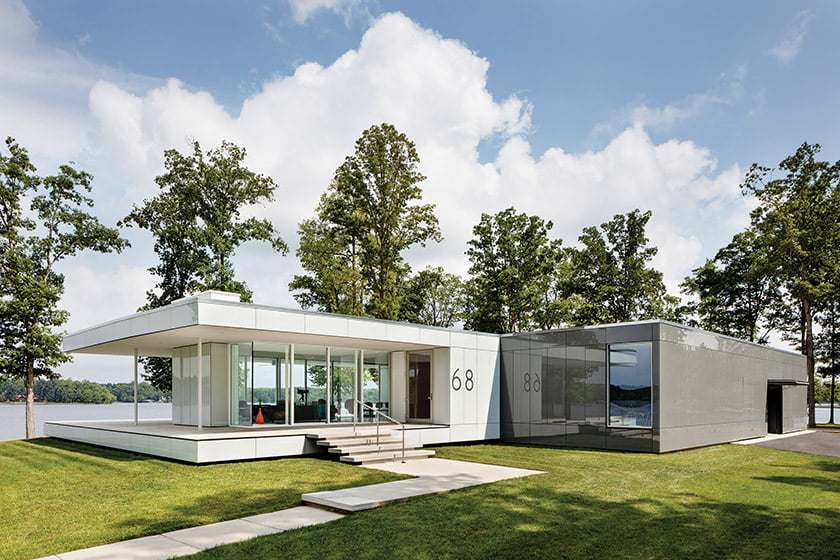 The home's exterior is sheathed in a colored glass cladding system by Sto.