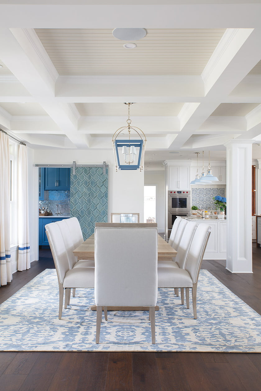 On the open-plan main floor, a formal dining area features a Century table and Hooker chairs.