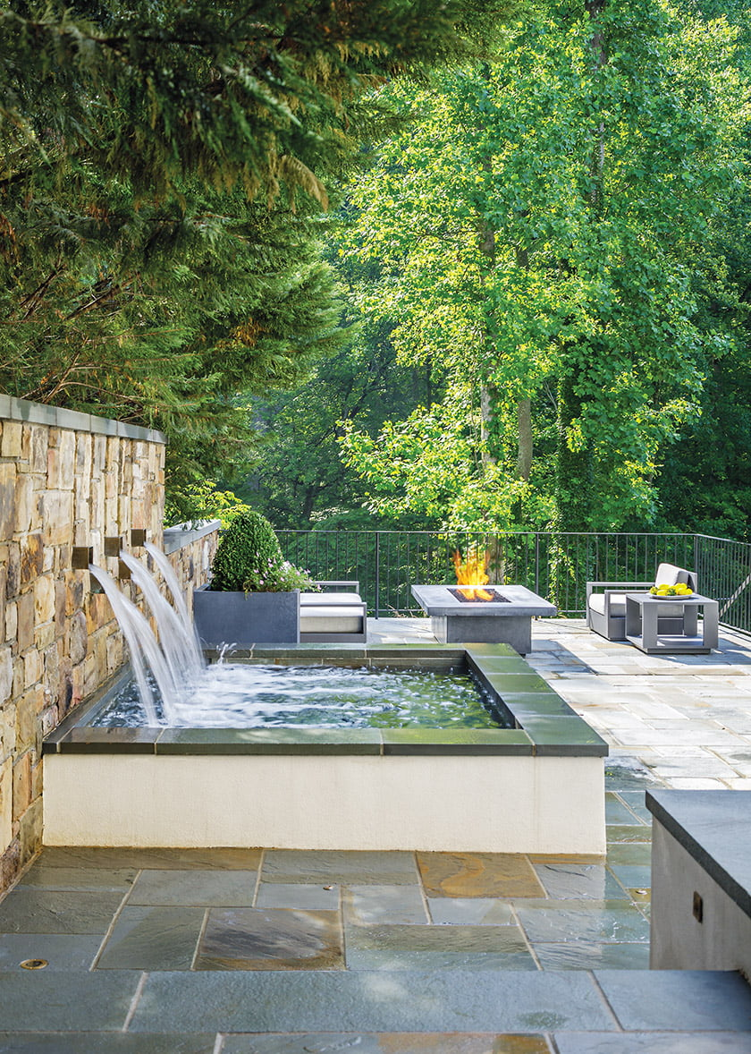 An accent wall of Western Maryland stone anchors the spa, which doubles as a fountain when not in use.