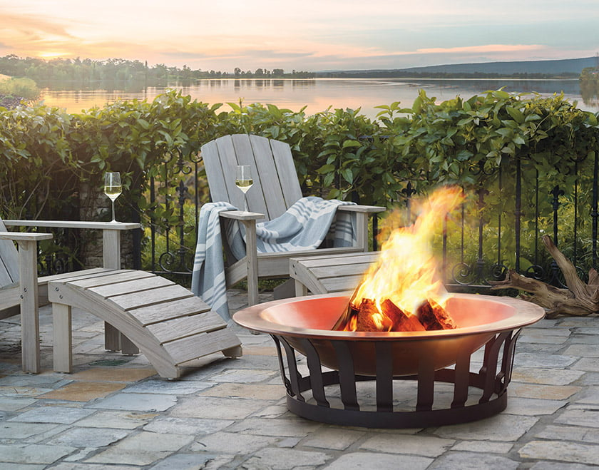 Frontgate's Classic Copper Fire Pit is designed to withstand extreme heat and weather.