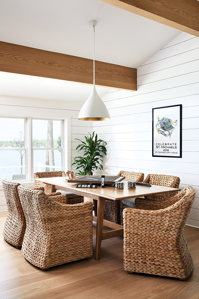 A Gat Creek table and woven RH chairs host games in the second-floor space.