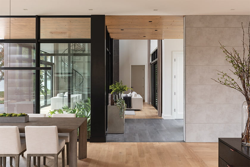 The foyer opens to a plant-filled courtyard that blurs the lines between indoors and out. Photo: Daniel Grehl